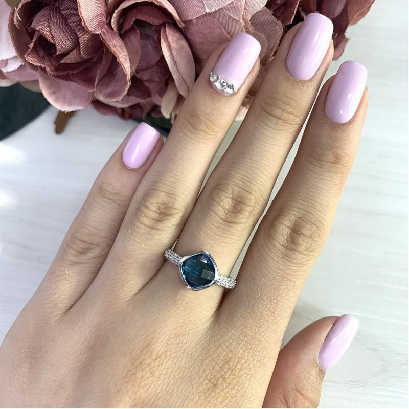Серебряное кольцо SilverBreeze с натуральным топазом Лондон Блю (2019930) 18 размер