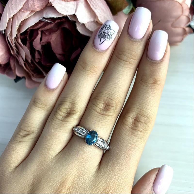 Серебряное кольцо SilverBreeze с натуральным топазом Лондон Блю (2010678) 18 размер