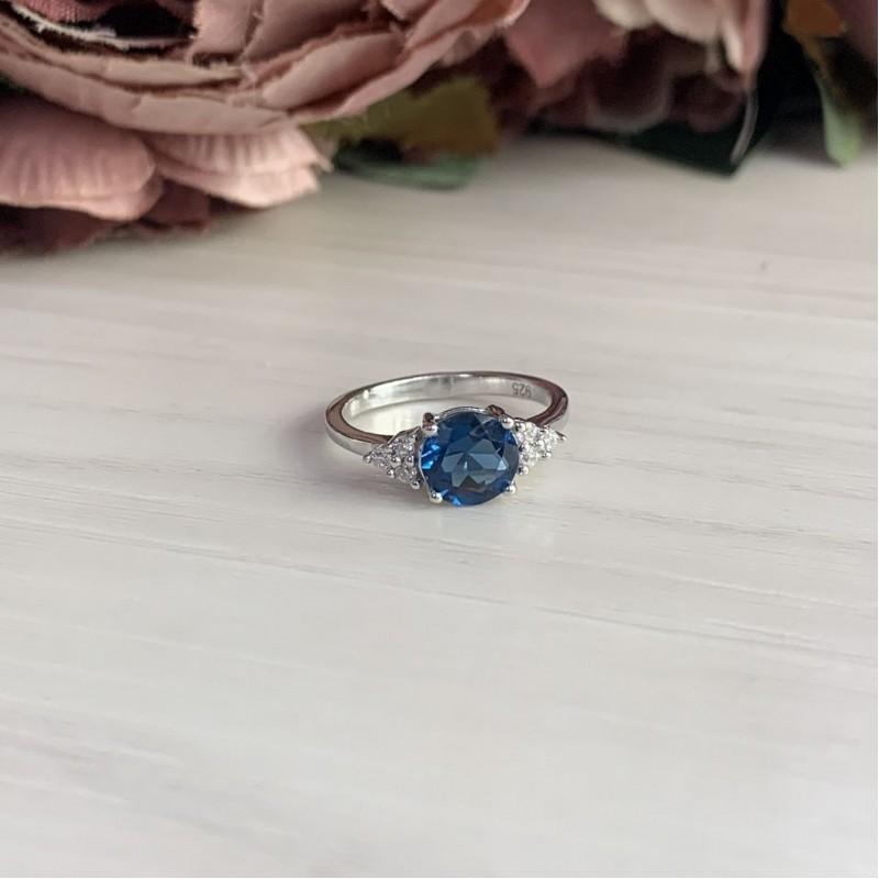 Серебряное кольцо SilverBreeze с натуральным топазом Лондон Блю (1074220) 16.5 размер